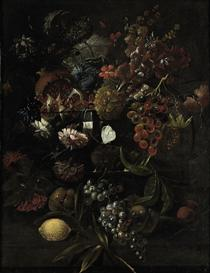 Various flowers in a glass vase with blue grapes, peaches and a lemon, all on a ledge - Mario Nuzzi